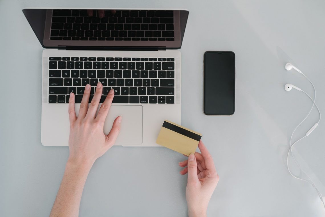 Person using credit card to buy products online