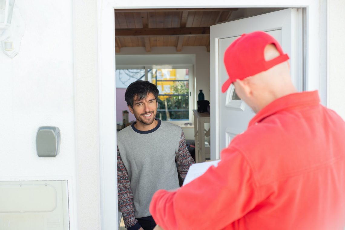 Person receiving delivery from shipping and fulfilment provider